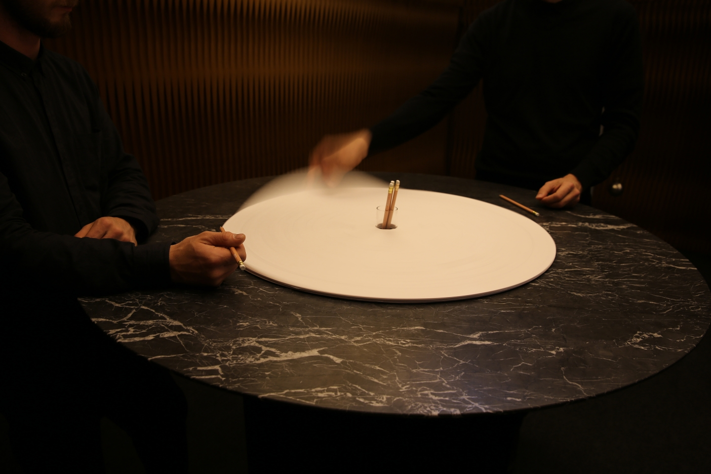 cantilever table by molo - molo's sketching circle accessory spins around a black Vancouver Island marble tabletop