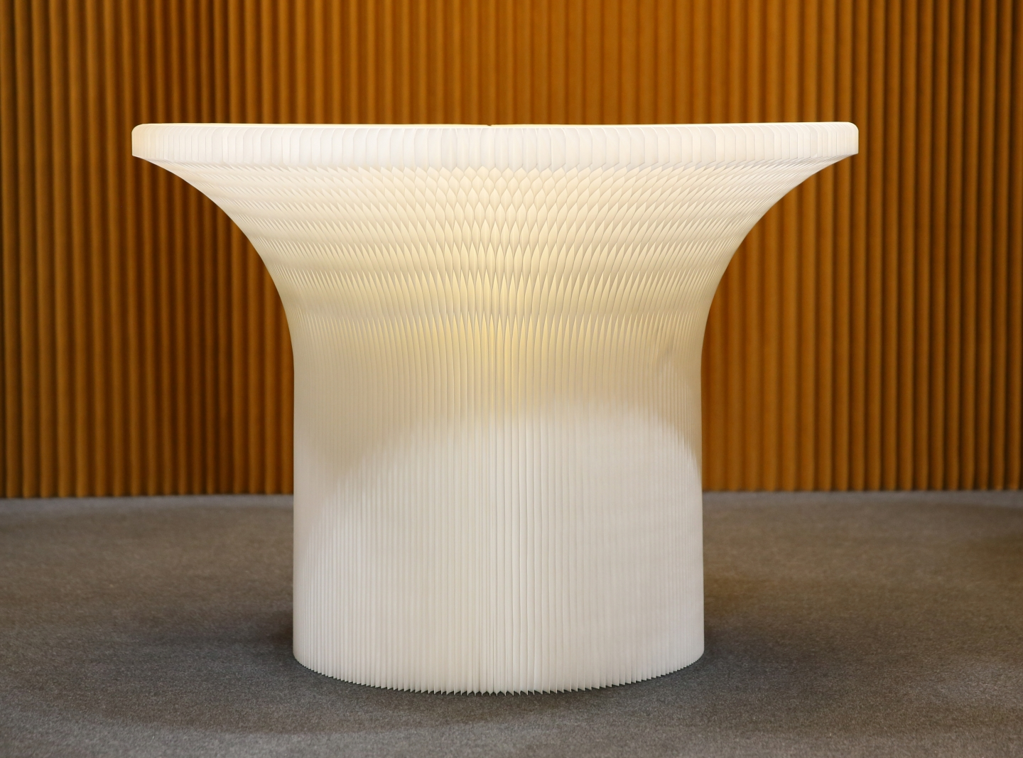 flexible paper accordion furniture by molo - the honeycomb base of a textile cantilever table