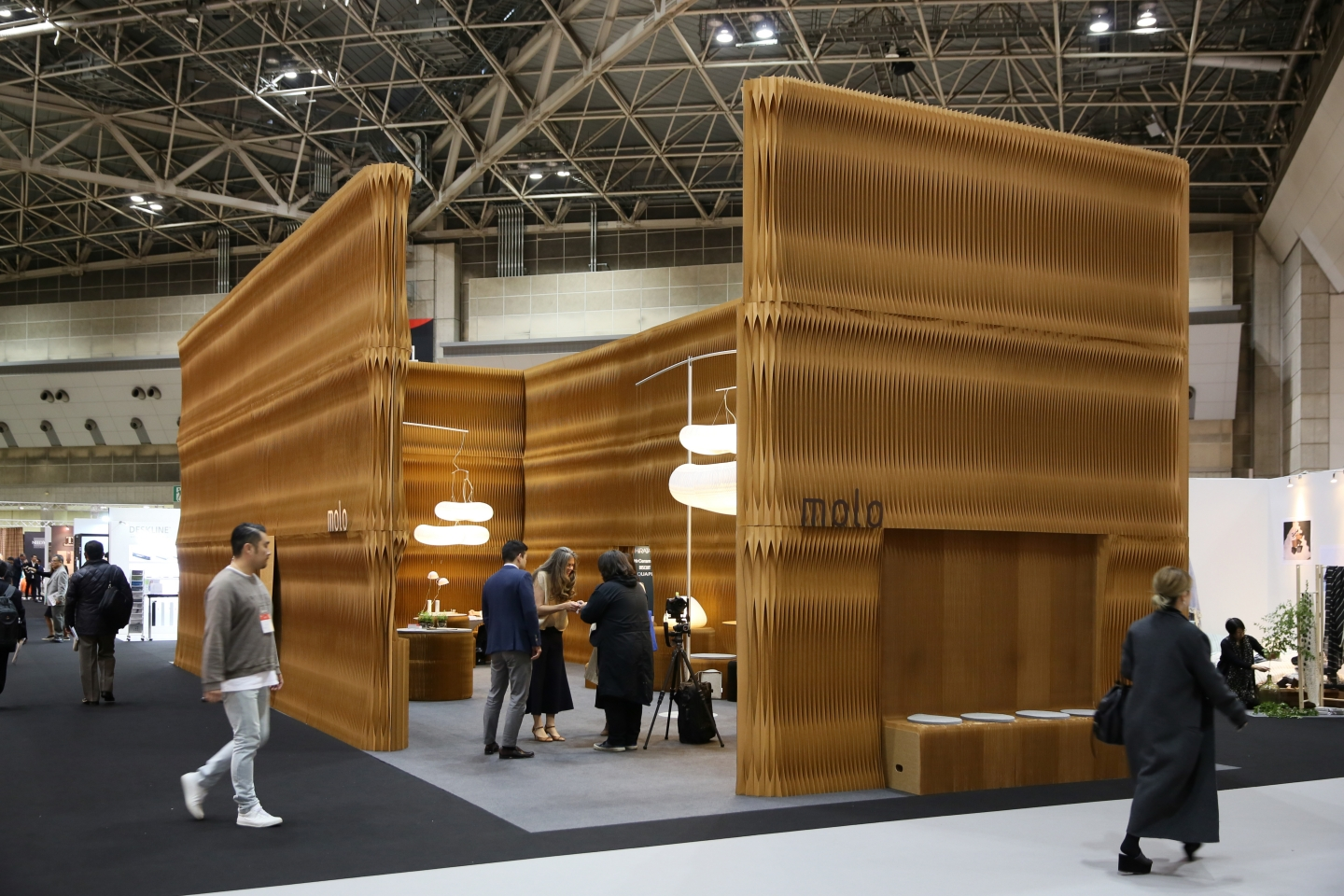 flexible paper accordion furniture by molo molo's - installation at IFFT in Tokyo, Japan