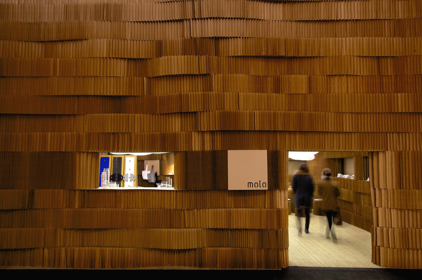 massive modular wall partition display - A wealth of textures created by undulating layers of paper softblocks.