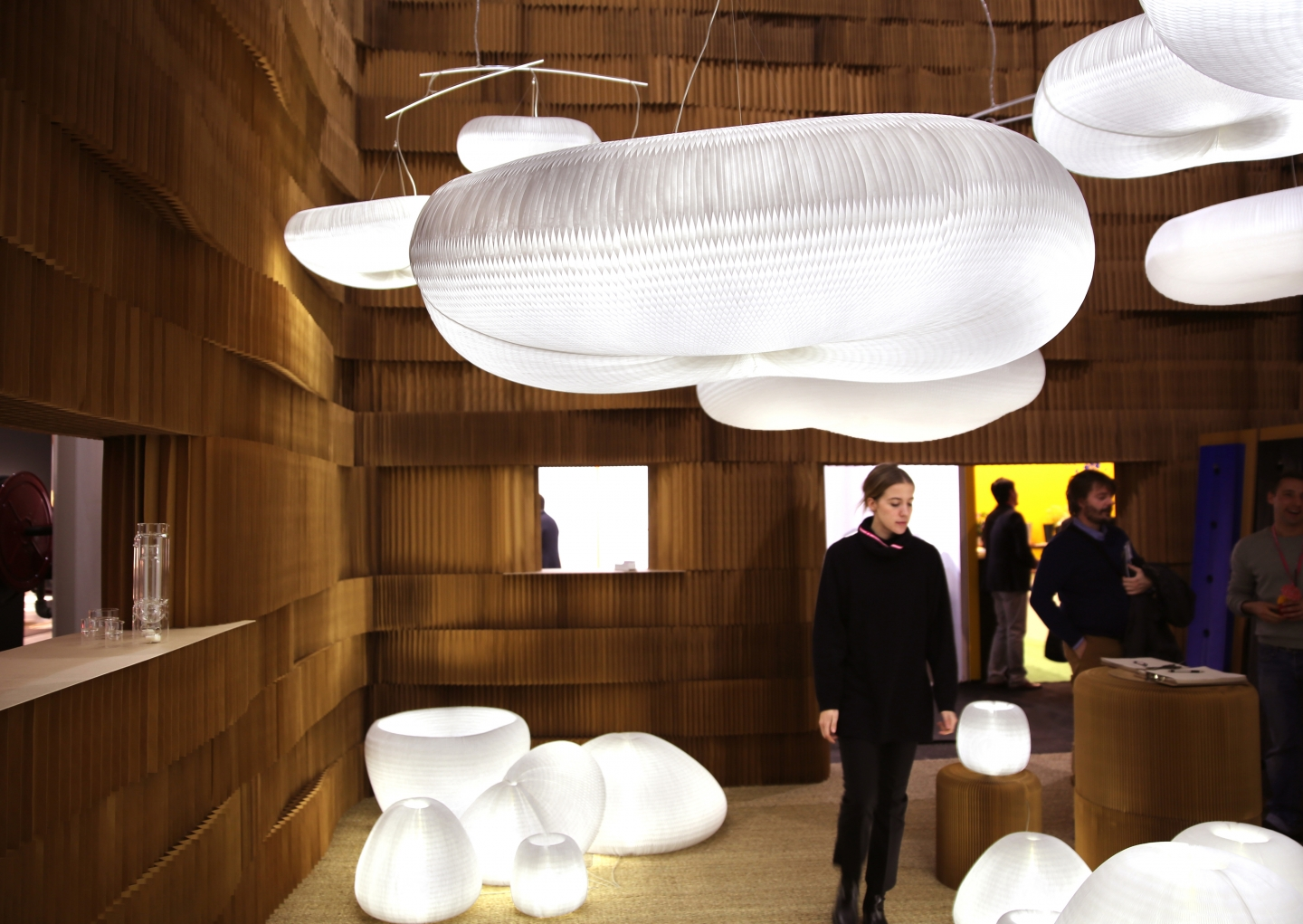 Guests drift through molo's booth at Maison & Objet, examining details of the soft collection. paper lighting