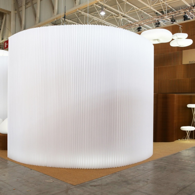 A wide view of the Maison & Objet installation, with a glowing textile softwall dominating the focus.