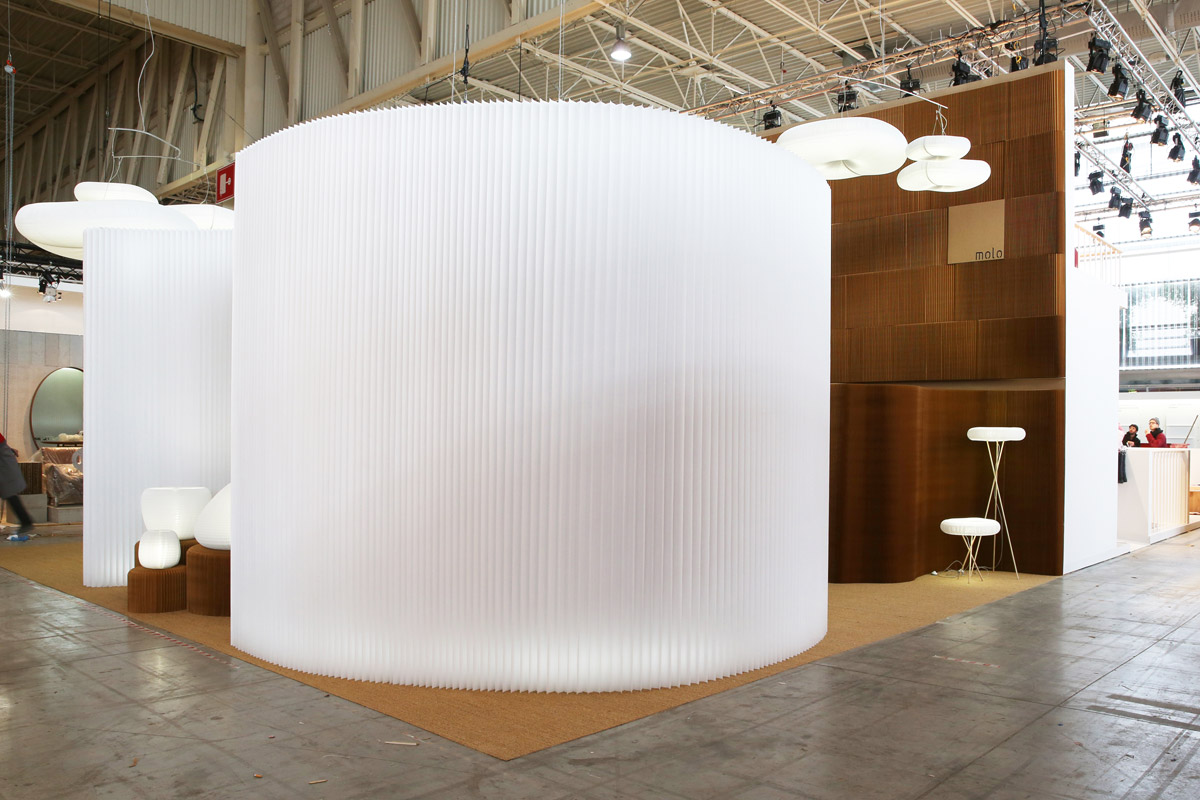 white modular textile wall partition and lighting by molo - A wide view of the Maison & Objet installation, with a glowing textile softwall dominating the focus.