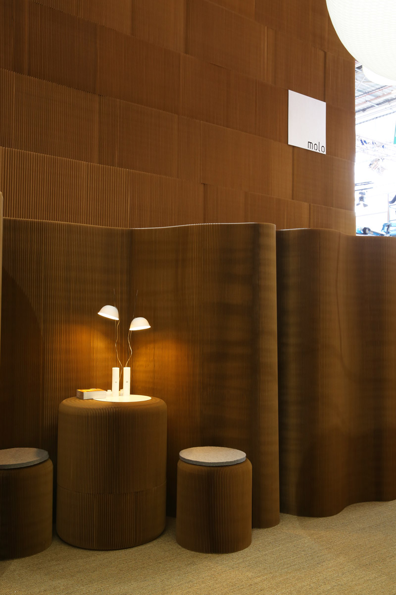 two cappellos cast gentle glow in an environment made completely from paper softseating and softwall + softblock.