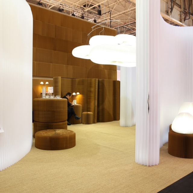 A side view of molo's installation at Maison & Objet in 2014, with softwalls framing a space to display cloud softlight and softseating.