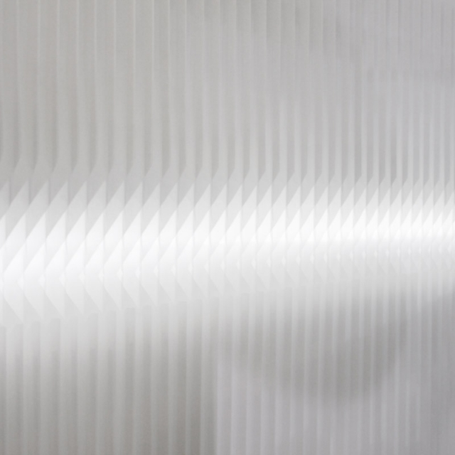 light shining through the notch cut of a modified textile softwall