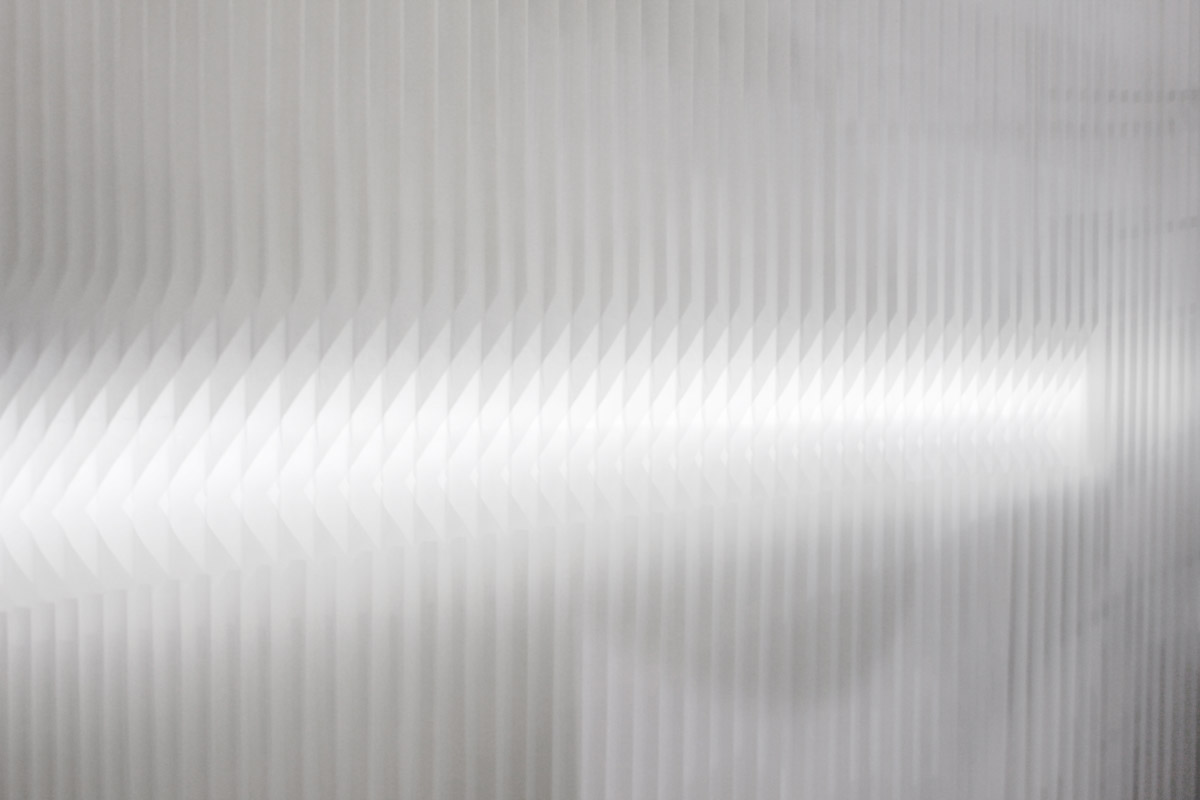 light shining through the notch cut of a modified textile softwall - freestanding textile partition wall