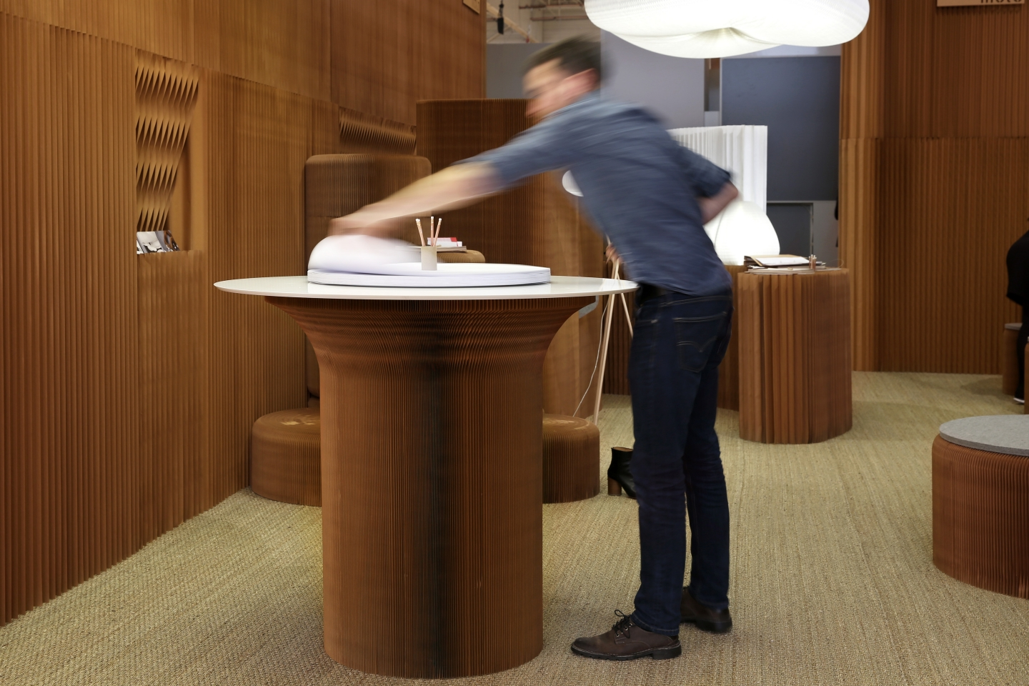 man adjusts the sketching circles accessory for a standing height cantilever table