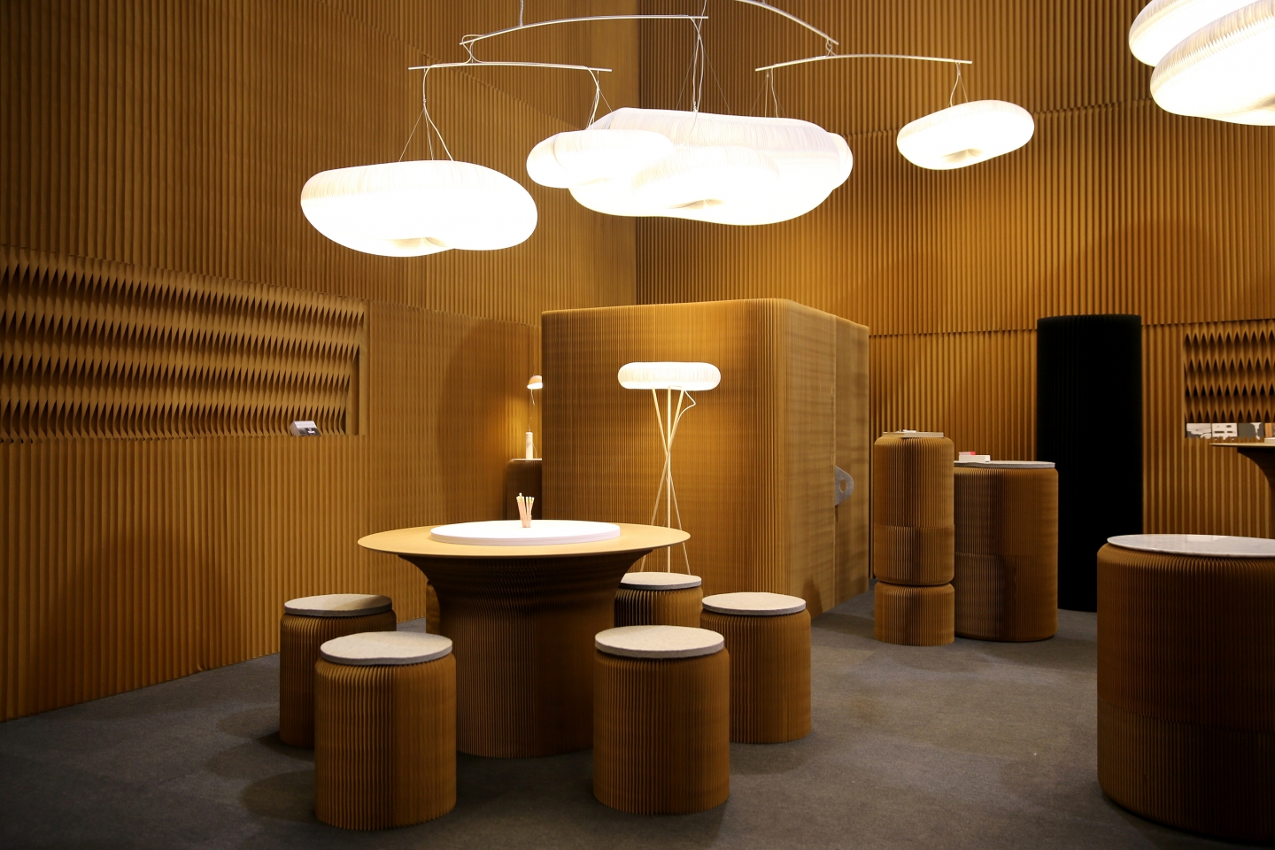 paper stools and cantilever table, cloud soft lighting - molo's installation at Maison & Objet, 2016