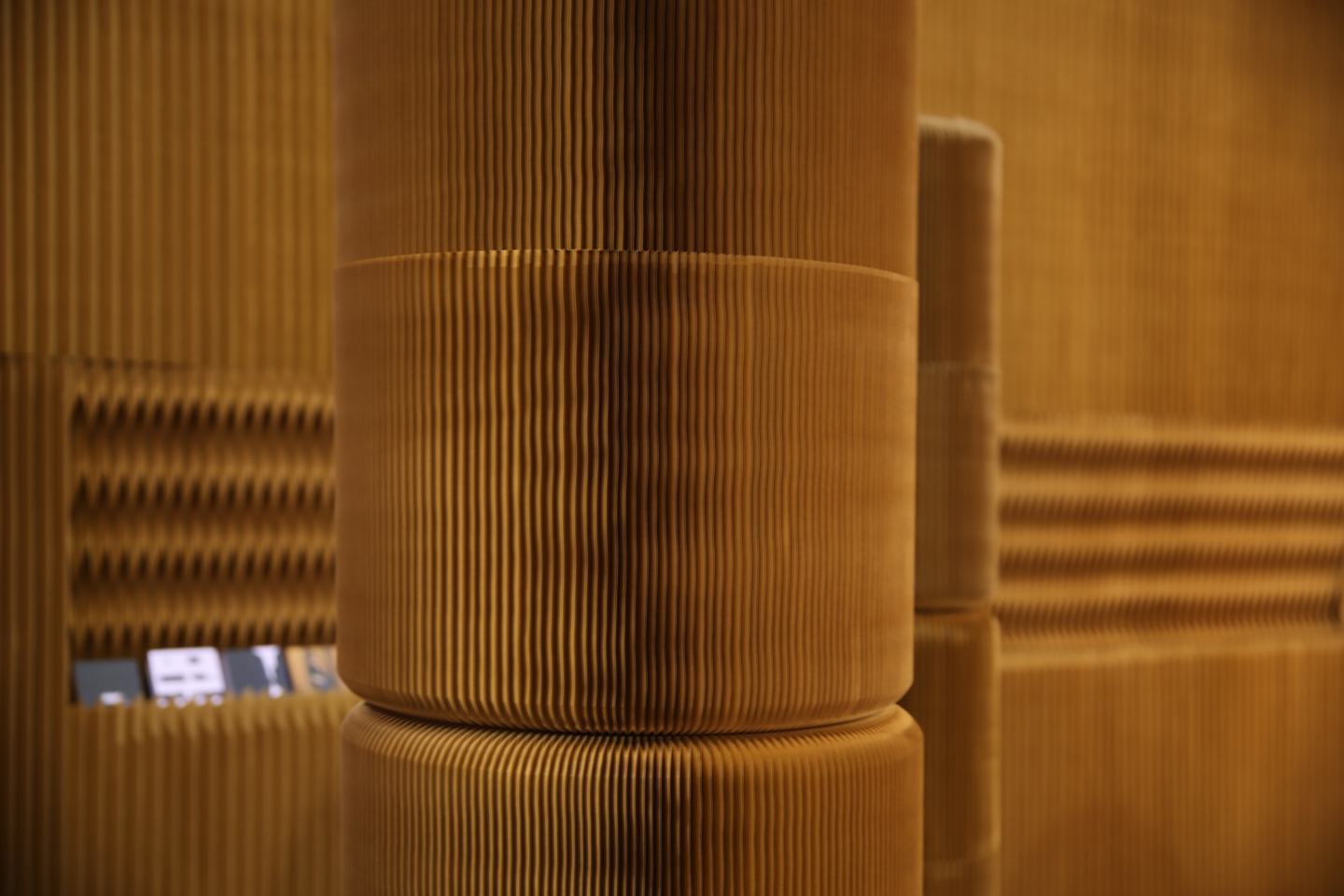 tree trunks, or columns made from stacked softseating fanning stools - modular paper furniture by molo