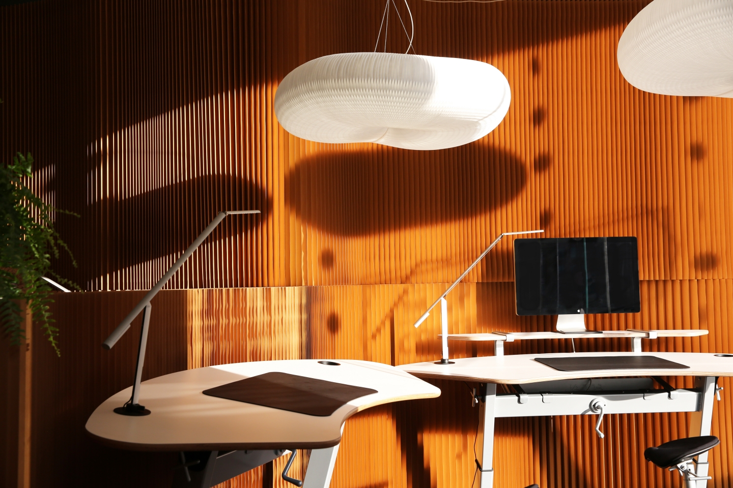 cloud lighting and modular paper wall partition - elements of the soft collection used to create a poetic office space