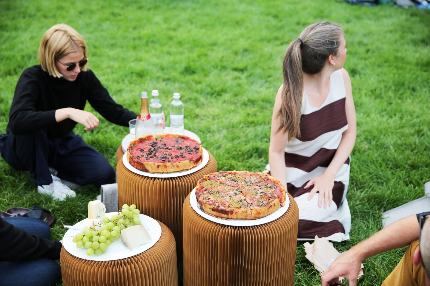 picnic in the park; enjoying Chicago deep dish pizza on tables made from softseating fanning stools - paper stool by molo