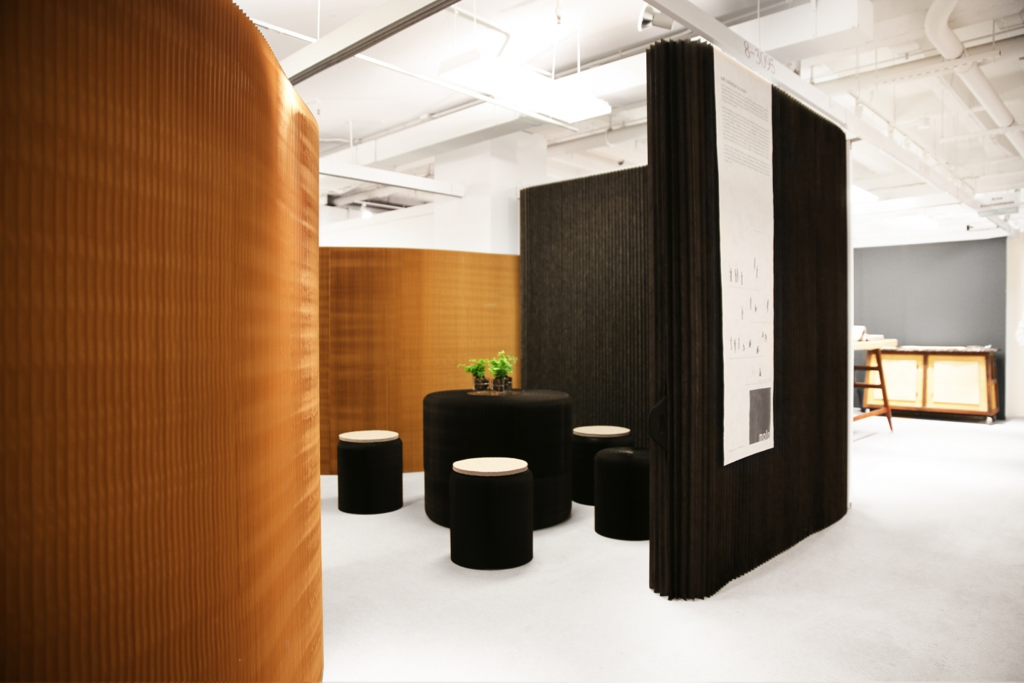molo's installation at Neocon 2014 featured the premiere of benchwall and thinwall modular system - portable wall partition and paper chairs in black