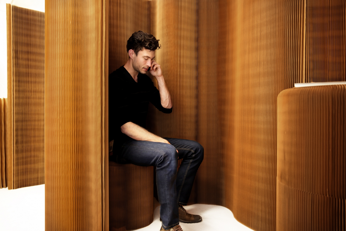 a man uses a thinwall nook to have a private phone call