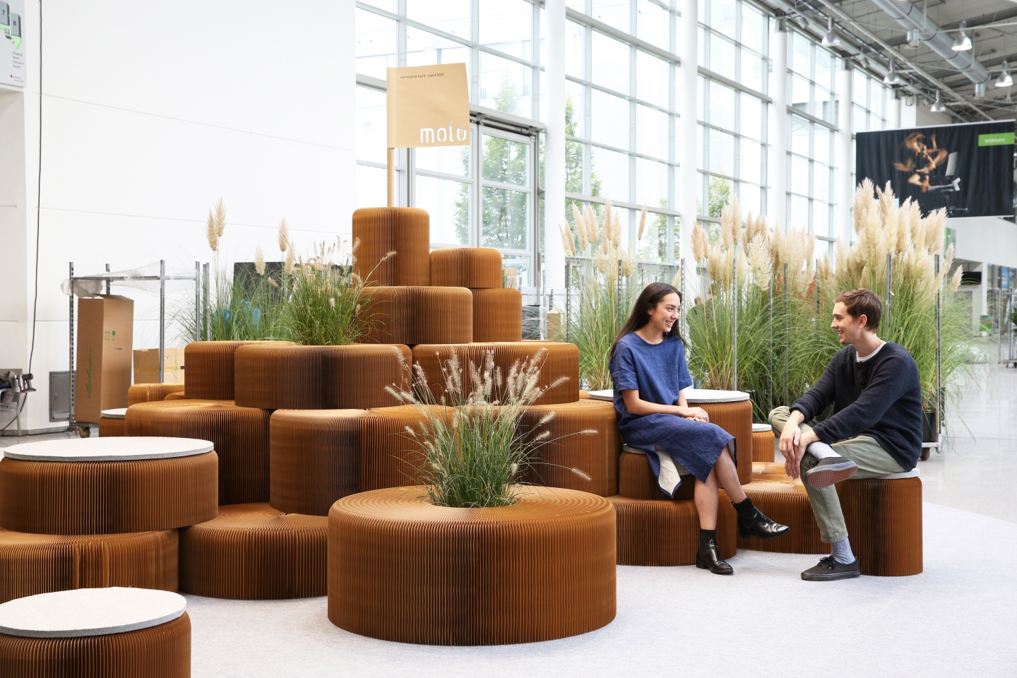 modular paper furniture by molo - a hill made from softseating and live plants at Orgatec 2014