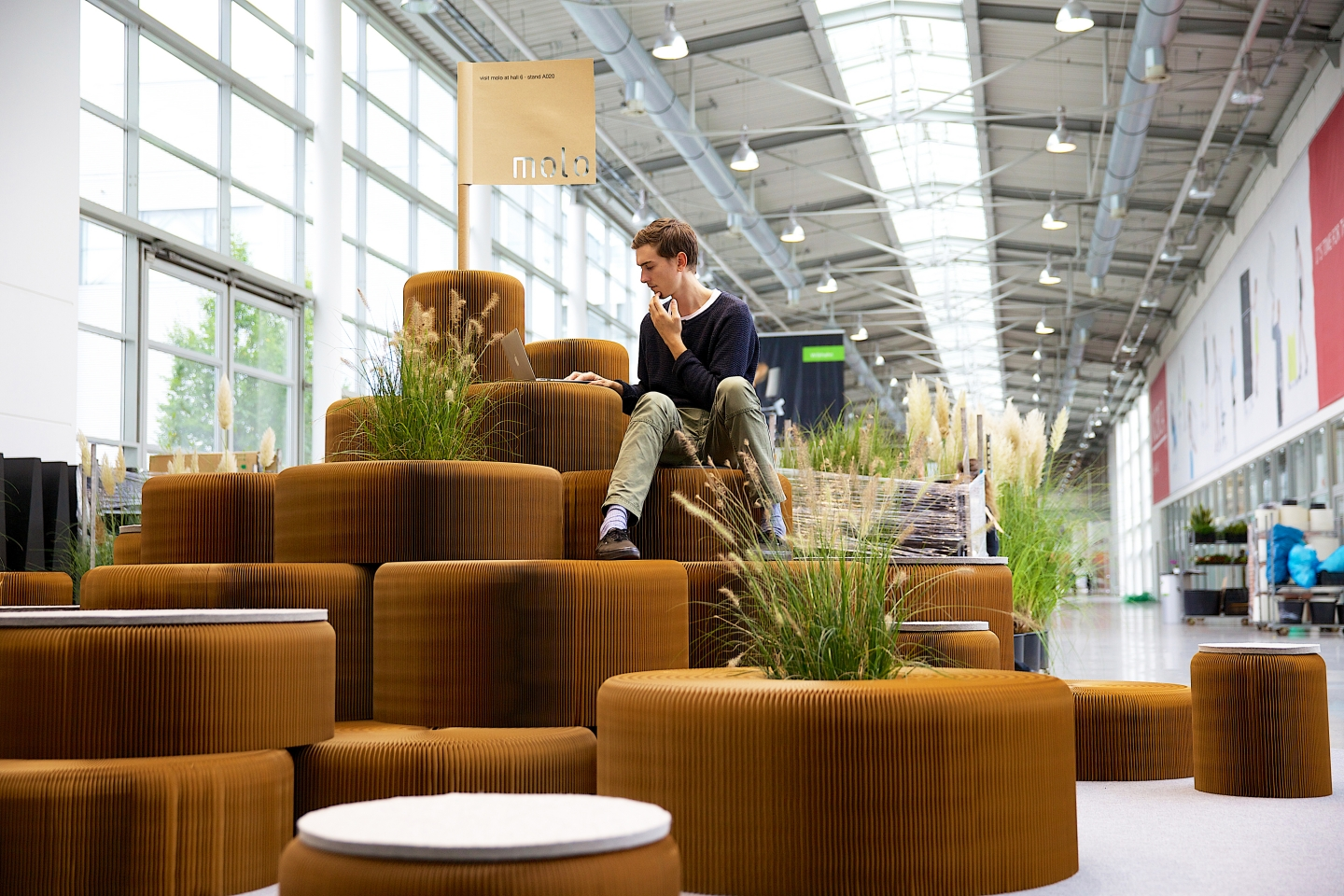 modular honeycomb paper furniture by molo - a hill made from softseating and live plants at Orgatec 2014