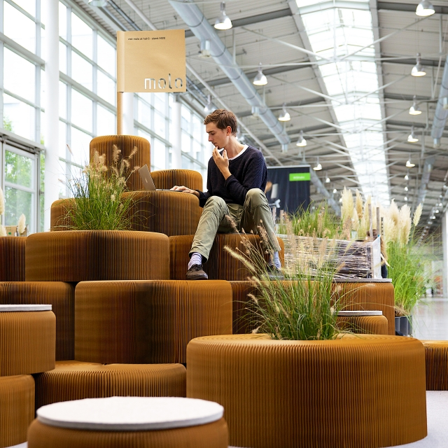 a hill made from softseating and live plants at Orgatec 2014