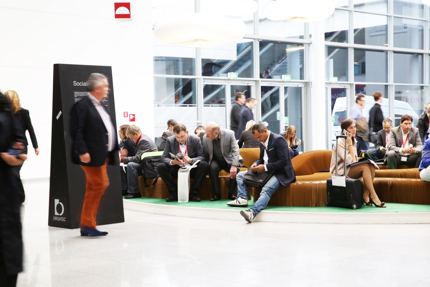 paper bench / furniture by molo - a serpentine bench made from softseating set up in the central foyer of Orgatec