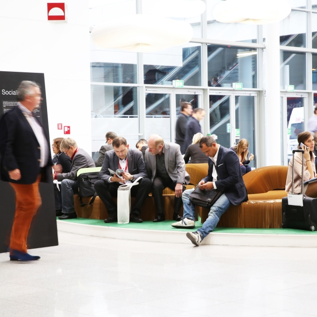 a serpentine bench made from softseating set up in the central foyer of Orgatec