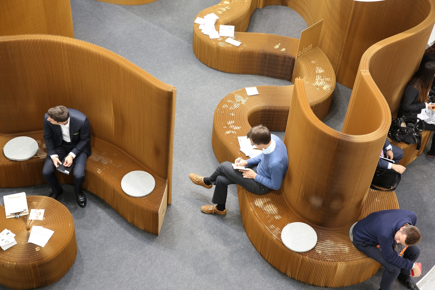 modular paper benchwall highbacked seating illuminate by cloud lighting by molo - with use over the course of the trade show, the surface of benchwall crushes into a pleasing patina