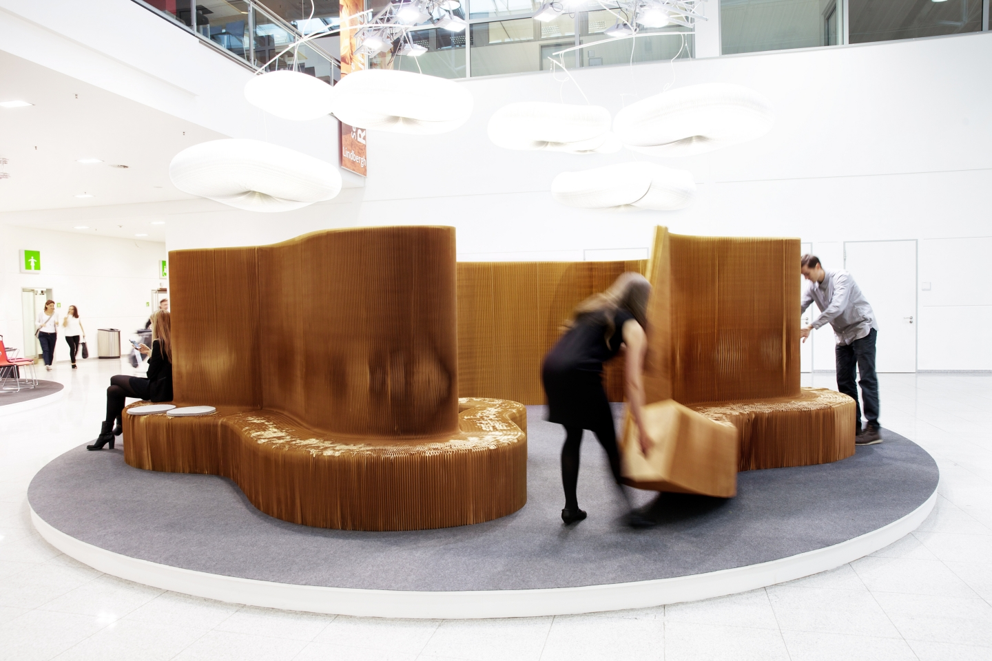 cloud lighting / accordion paper furniture by molo - setting up the special display of benchwall for Orgatec 2014