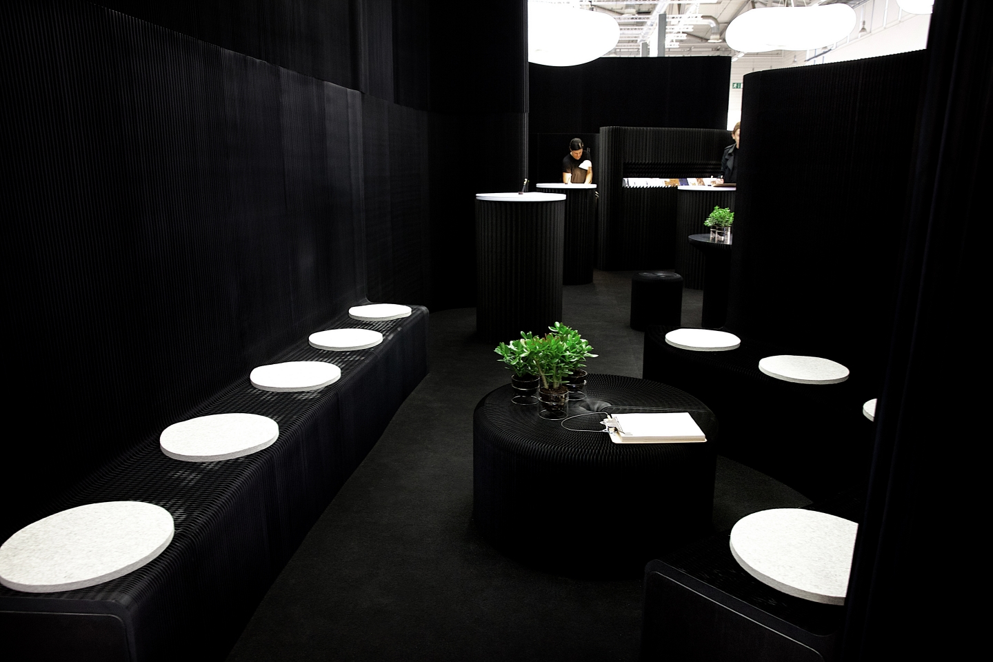 cloud lighting / custom accordion paper furniture in black by molo - molo's installation at Orgatec 2014 featured benchwall, thinwall, wool felt pad and prototypes of cantilever table