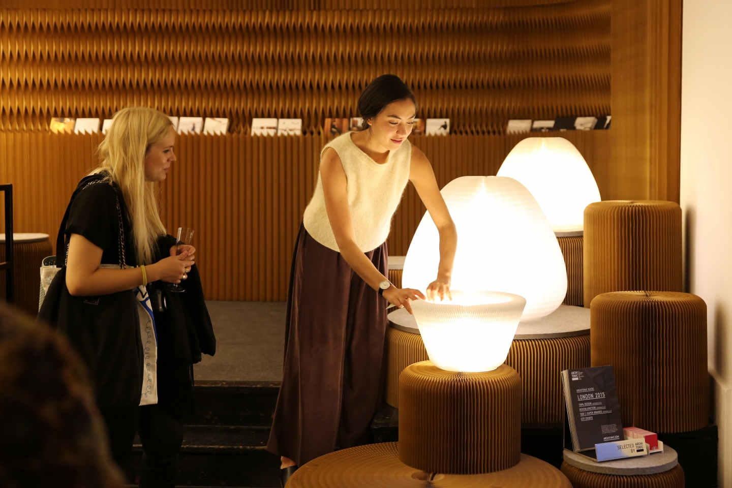 paper lighting and seating by molo - woman turns cloud softlight inside out to demonstrate its flexible form