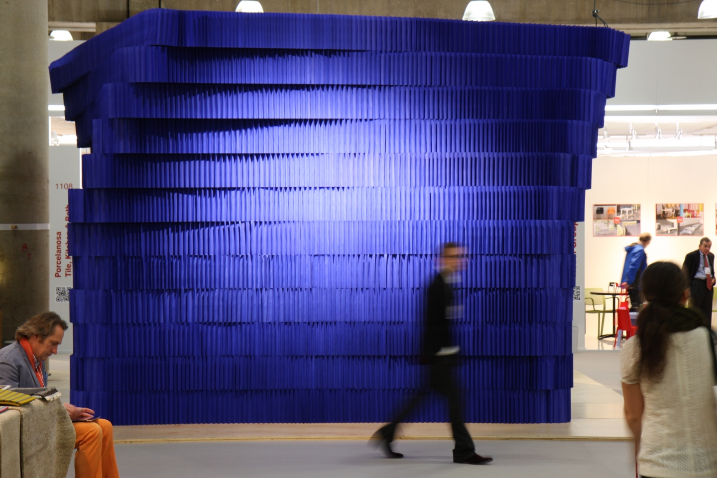 indigo paper softblock / modular room divider - silhouetted figure against the paper room at ICFF