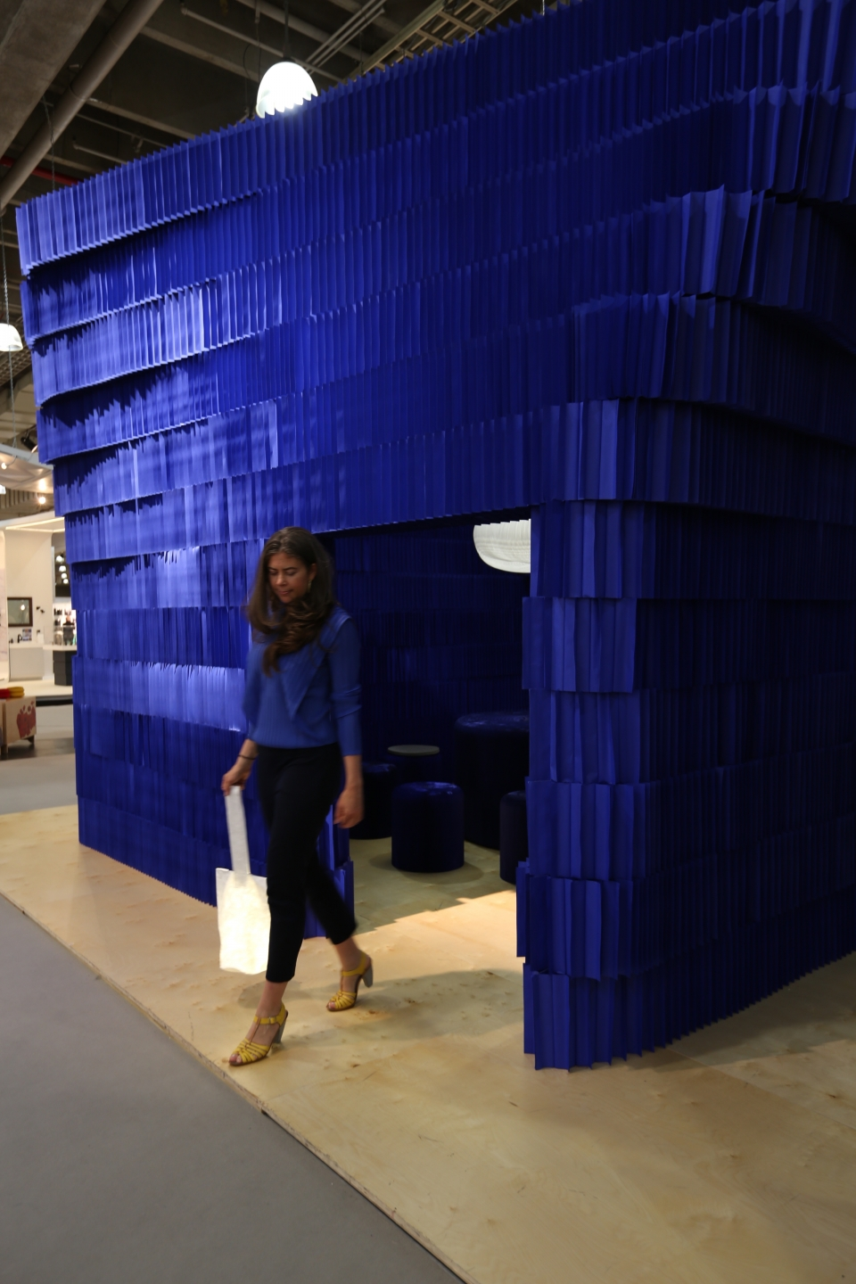 exterior view of molo's paper room at ICFF - indigo paper softblock / modular room divider - foldable paper stools by molo