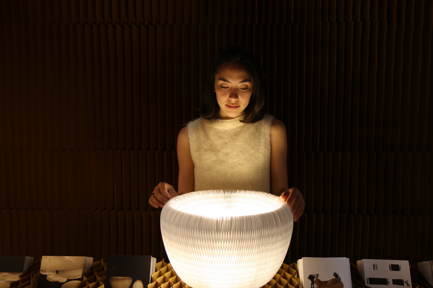 light bathes the face of a woman playing with an urchin softlight