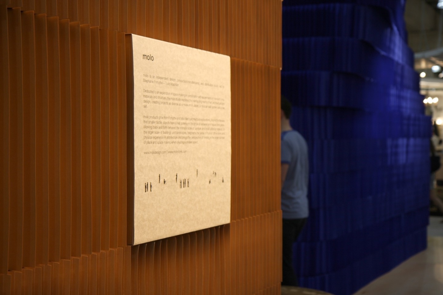 a man disappears behind a stack of softblocks at ICFF