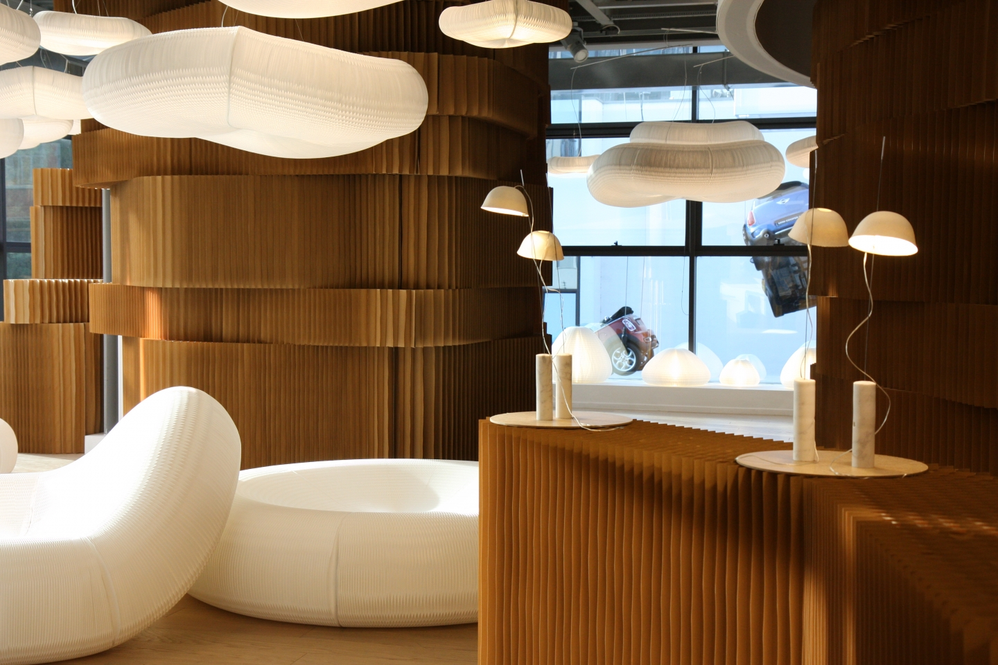 paper room divider and funiture - molo's booth at Superstudio Piu showcased textile loungers, cloud softlight pendants and brown paper softblocks.