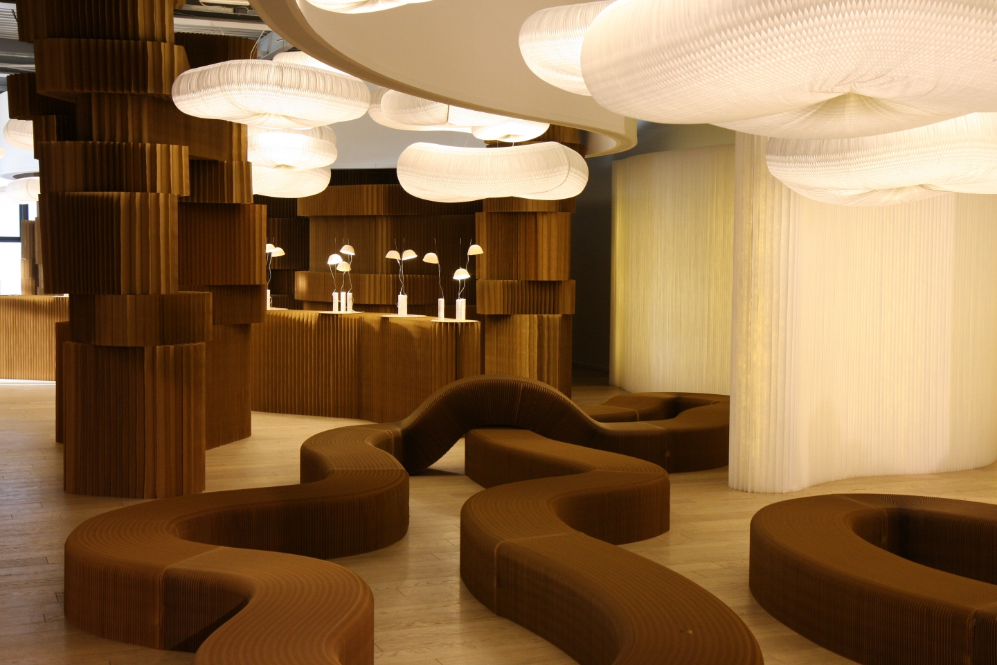 paper furniture and paper lighting - molo's booth at Superstudio Piu showcased textile loungers, cloud softlight pendants and brown paper softblocks.