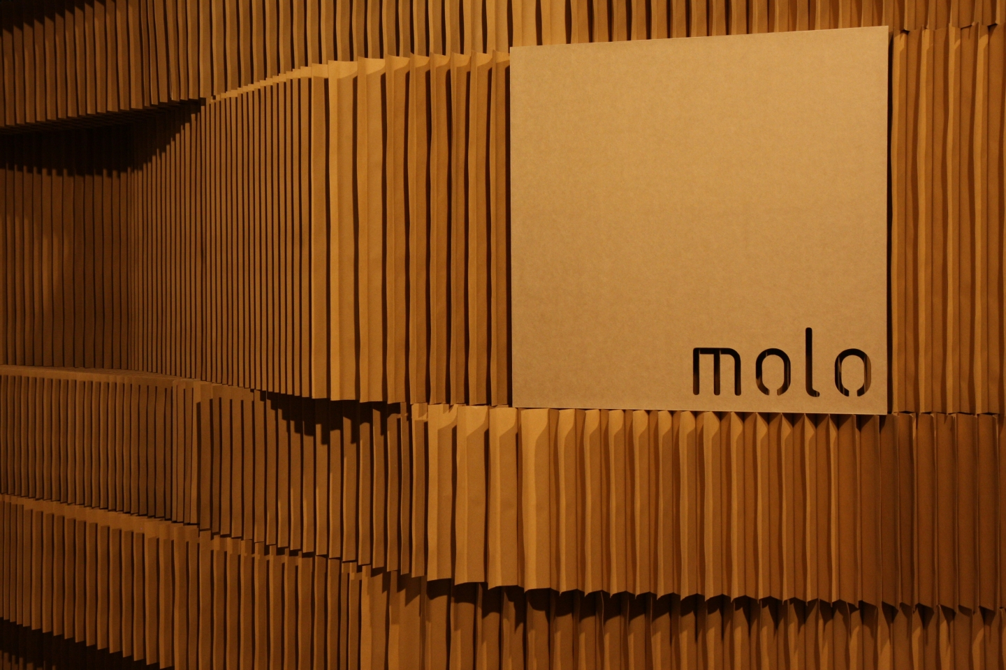 detail of molo signage inserted into the gaps of stacked softblocks.