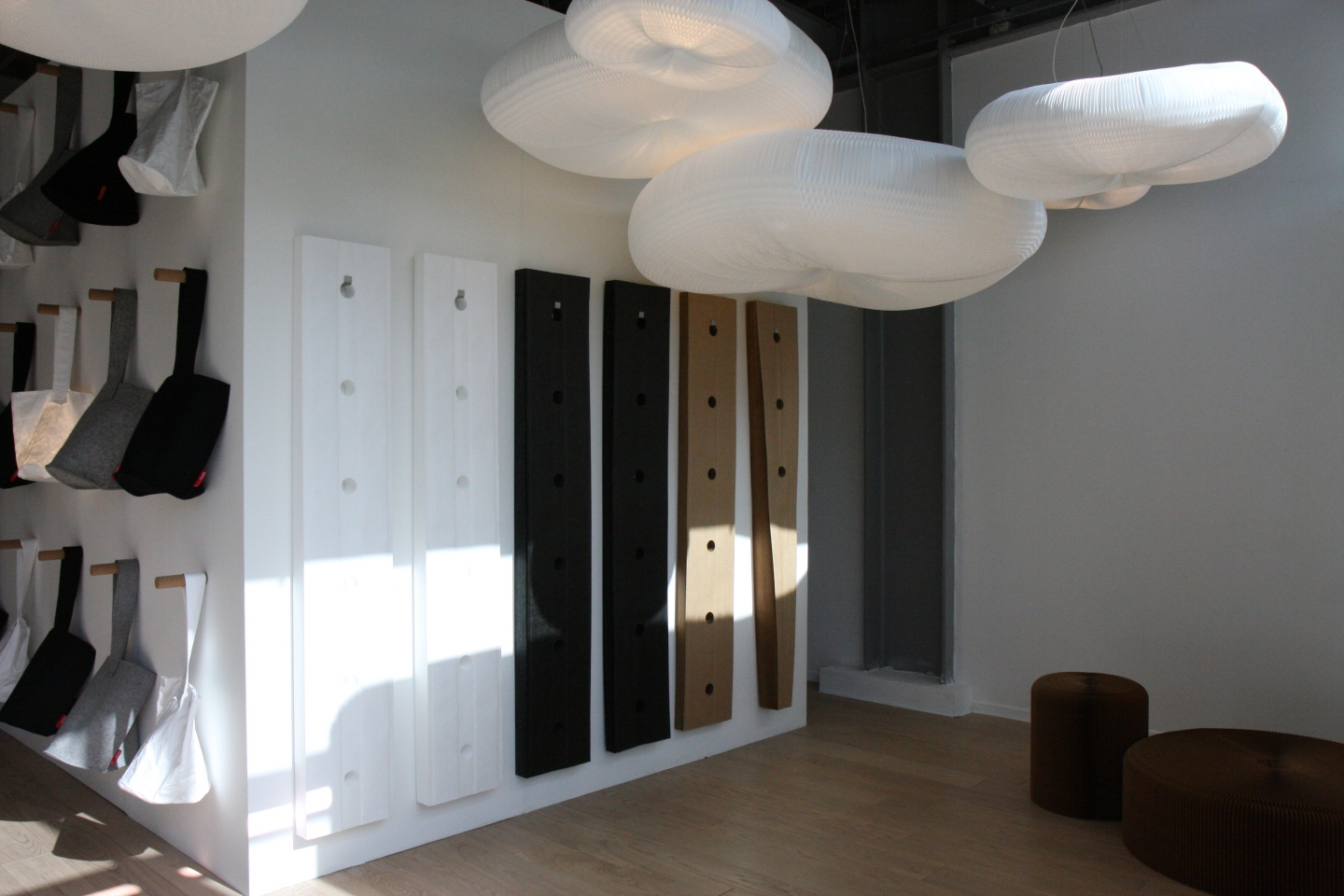 softwalls stored compressed and hanging from wall hooks.