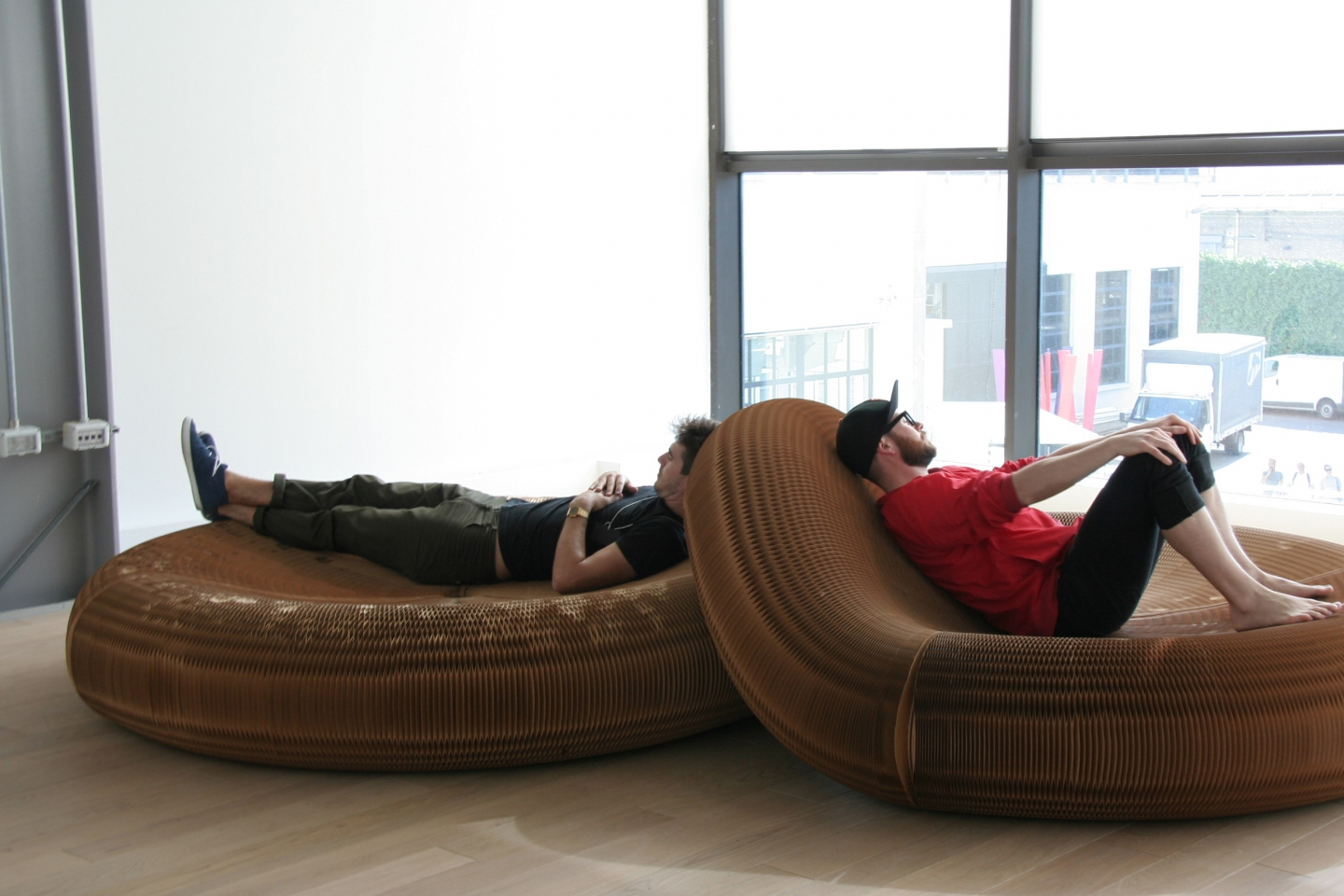 Two men take a rest on softseating lounger.