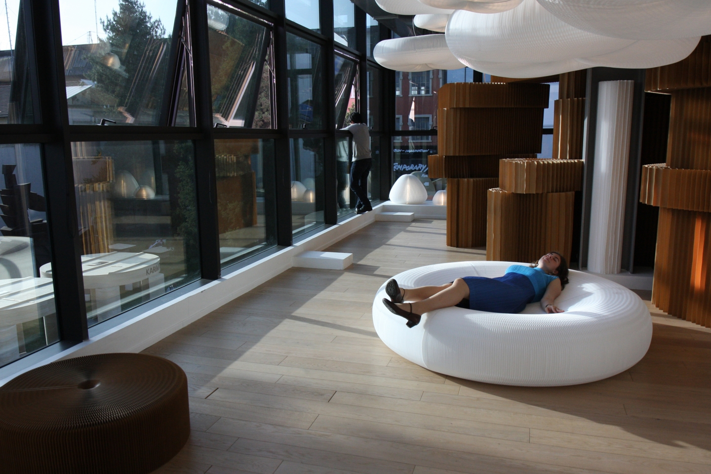 A woman relaxes on a softseating lounger at Superstudio Piu.