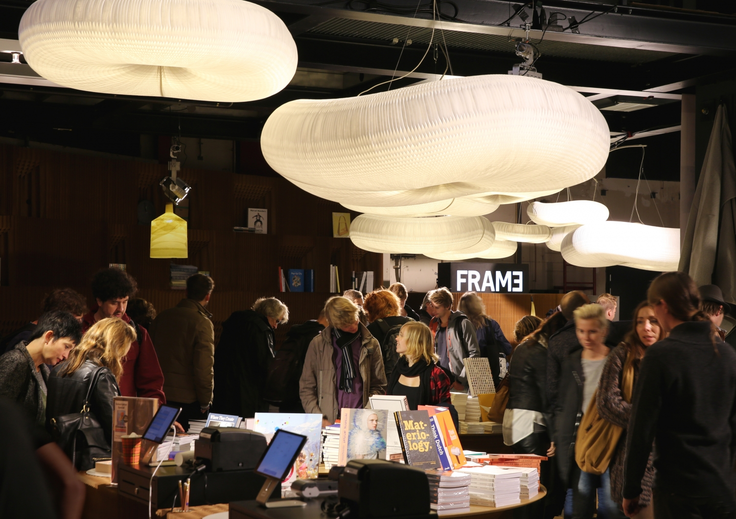 cloud lighting by molo - molo's various table and seating elements easily double as surfaces for product display, as in this booth for FRAME Magazine
