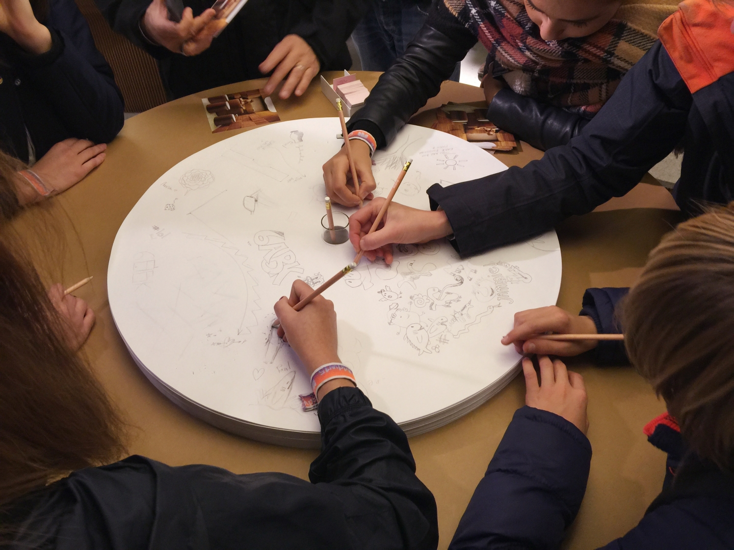 sharing ideas with the sketching circles accessory for cantilever table at Dutch Design Week