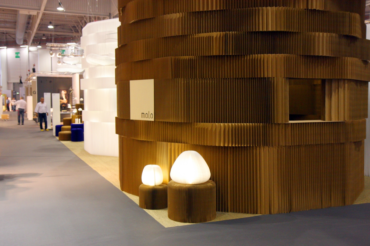 paper furniture display for molo - Two towers of softblocks, one in paper and the one in textile. A pair of urchin softlights glow in the foreground.