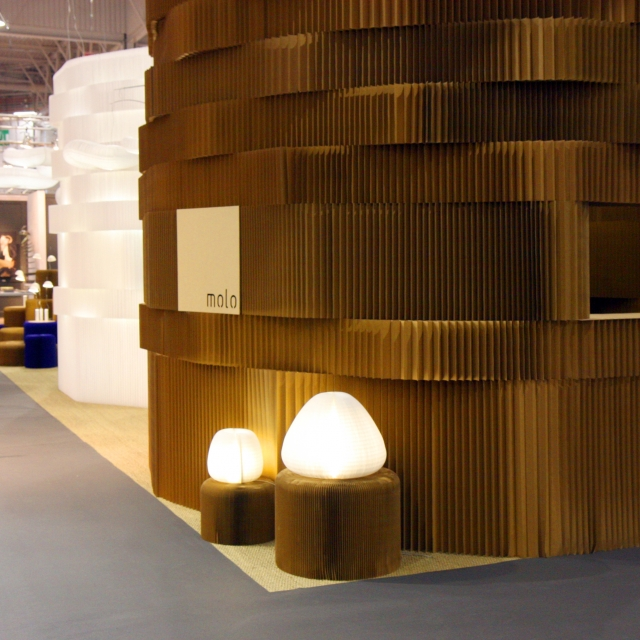 Two towers of softblocks, one in paper and the one in textile. A pair of urchin softlights glow in the foreground.