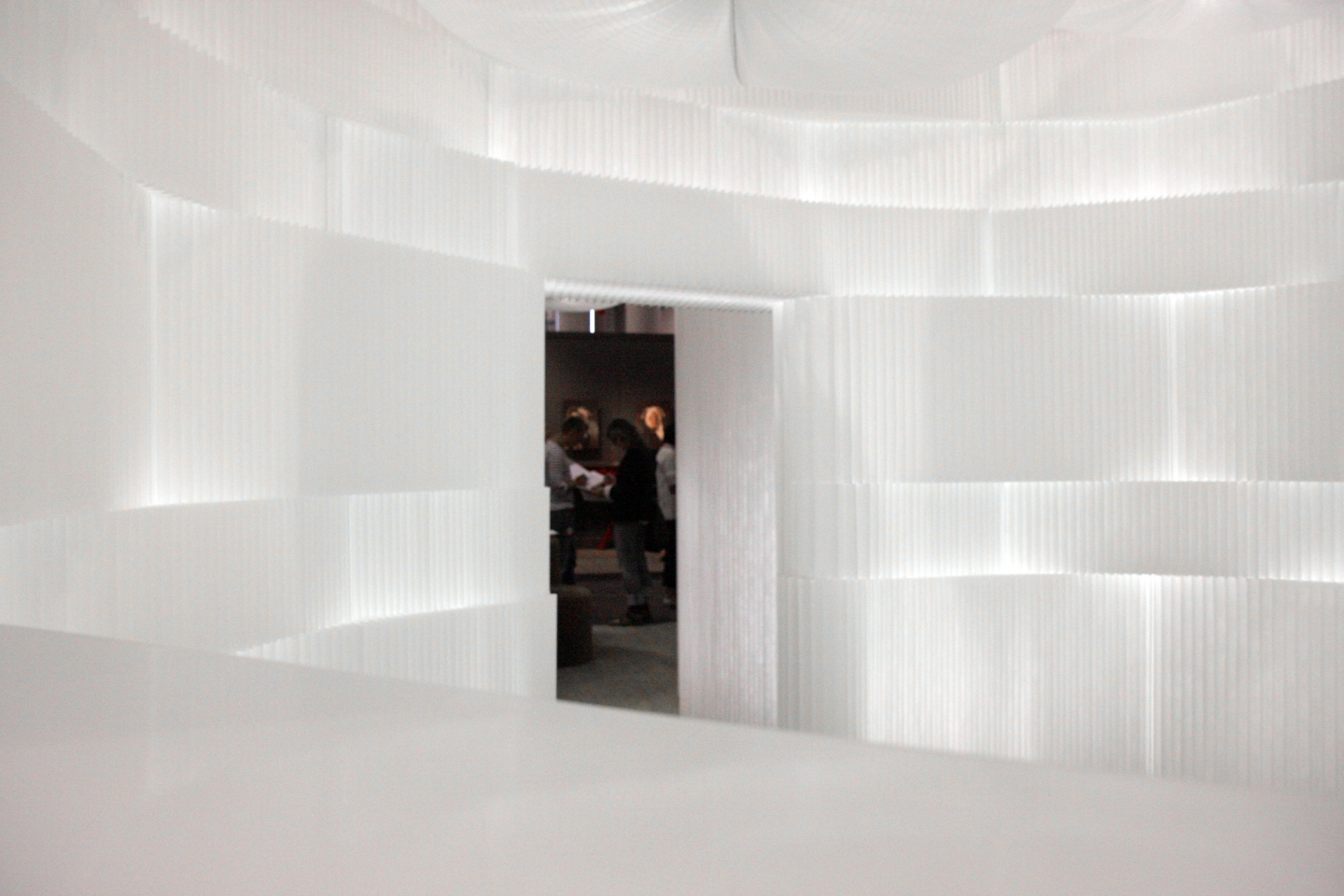 A room of gentle light; illuminated by cloud softlight and LED integrated with textile softblock / modular room divider.