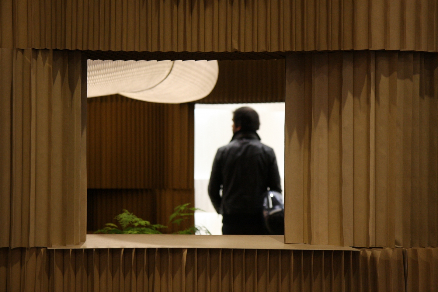 A visitor to Maison & Objet 2011 is framed by a window in the softblock structure - paper lighting.
