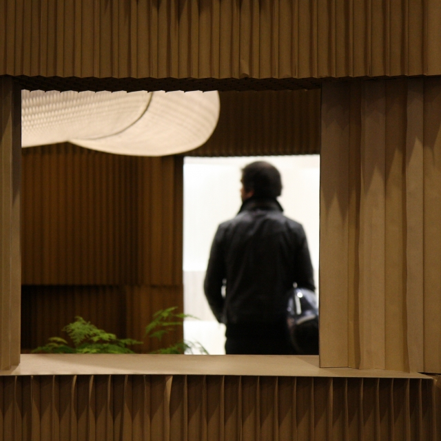 A visitor to Maison & Objet 2011 is framed by a window in the softblock structure.