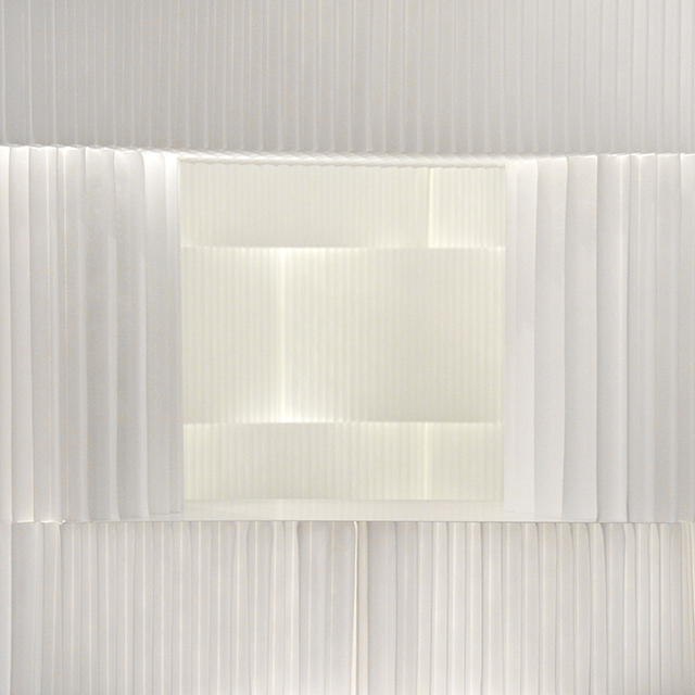 Light passing through textile softblocks / modular room divider.
