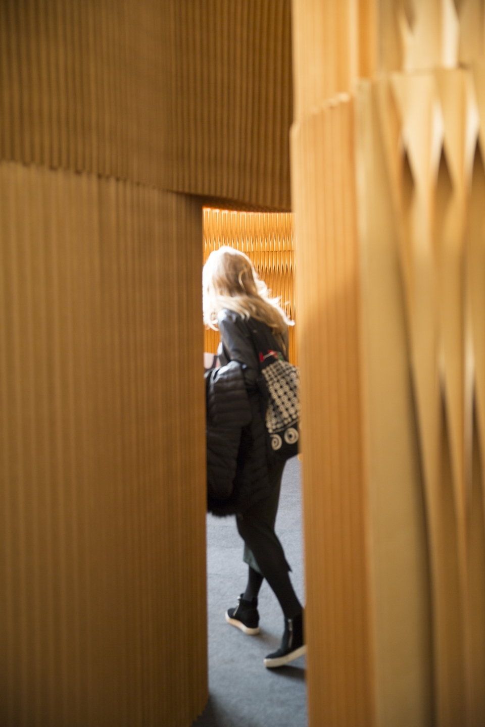 A woman explores the molo display at Maison & Objet 2018. accordion portable partition walls