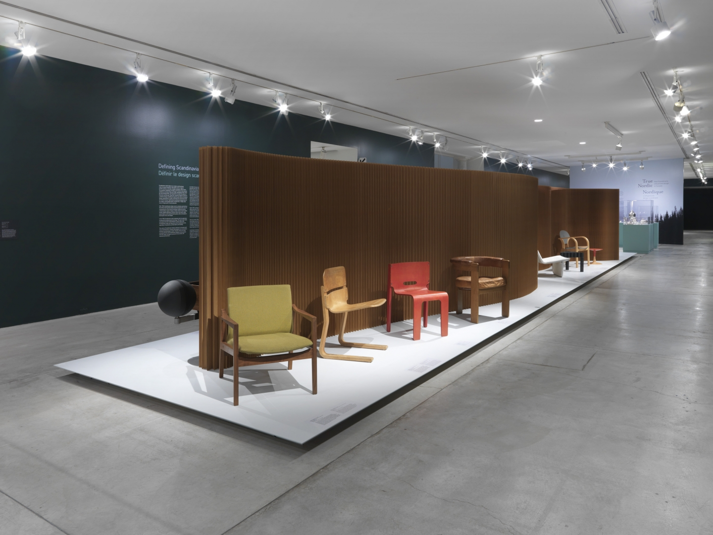 Various Canadian designed chairs against a softwall backdrop.