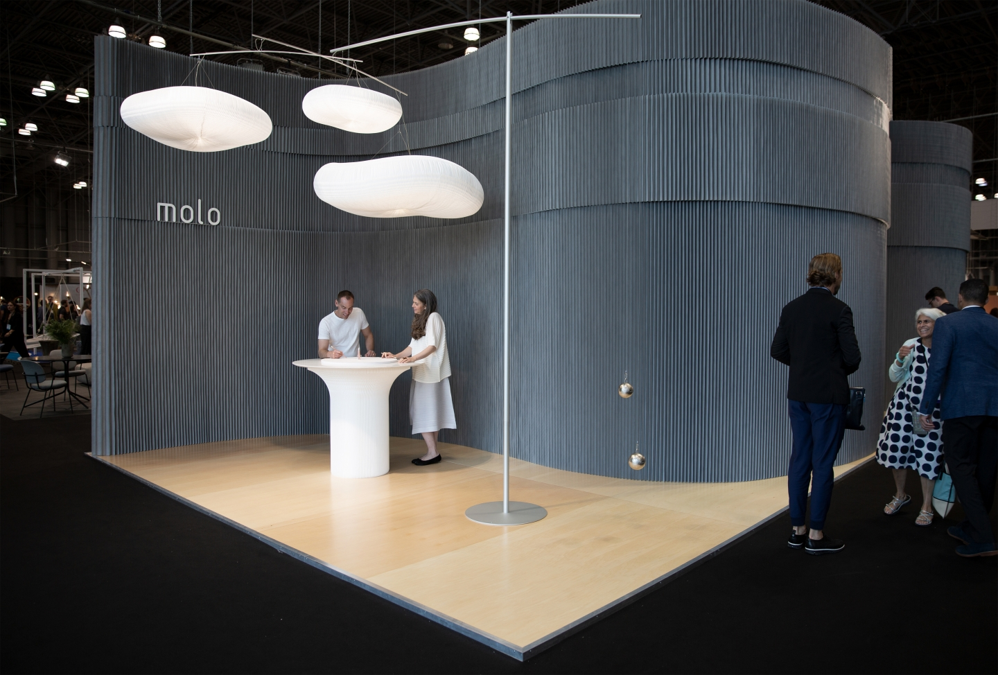 A white standing height table, made by molo, at ICFF 2018.
