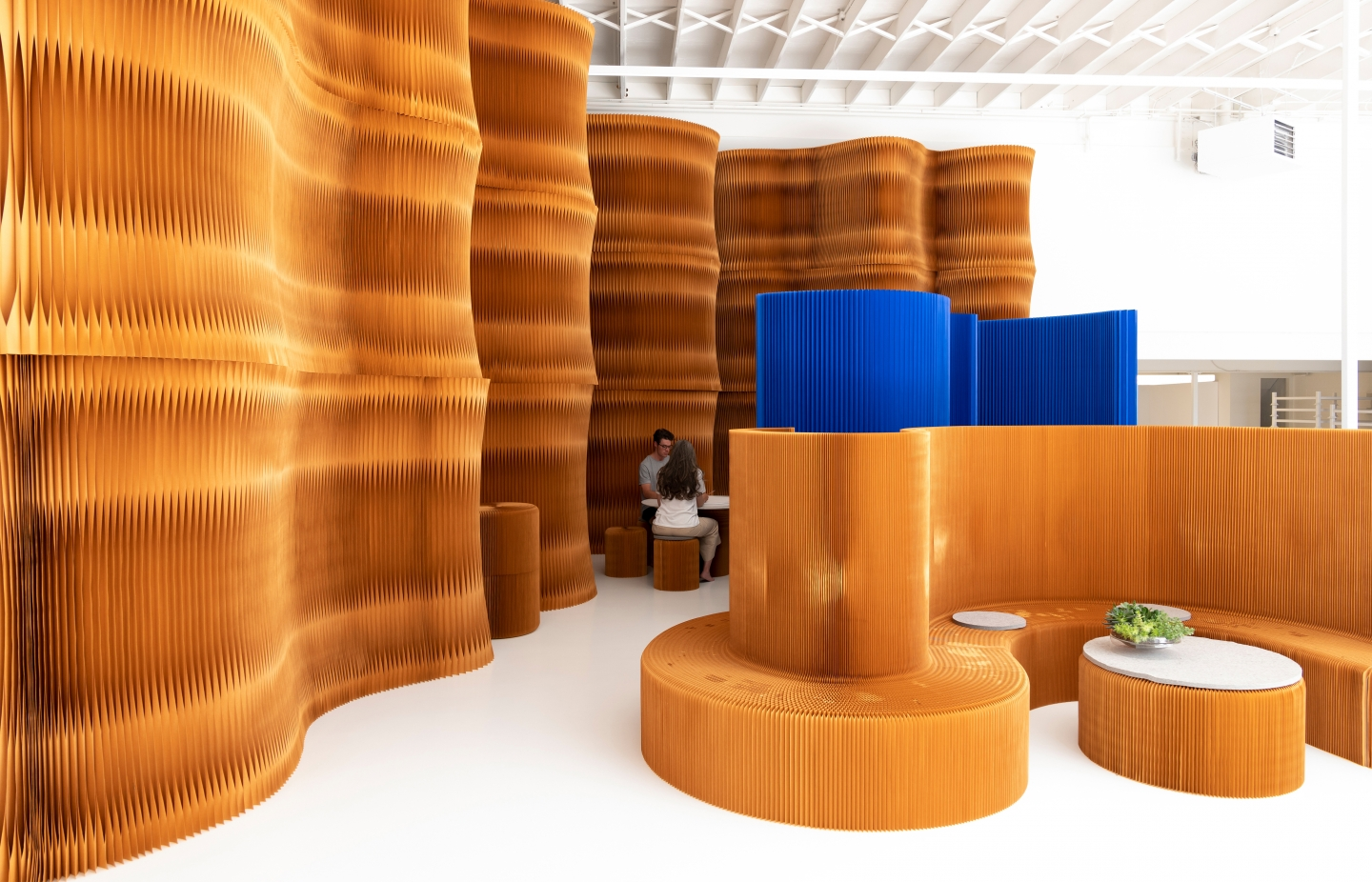 paper furniture exhibit at orgatec 2018 - molo's highbacked seating and paper softwall
