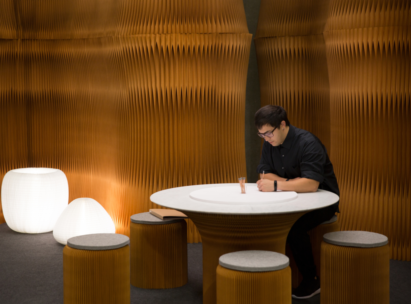 paper stool seating, cantilever table and accordion wall partition by molo - orgatec exhibit 2018